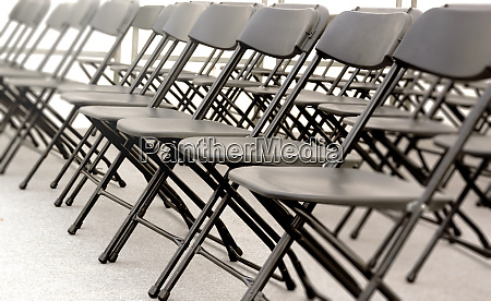 a group of black folding chairs