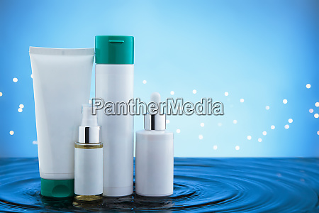 cosmetic products standing in water with
