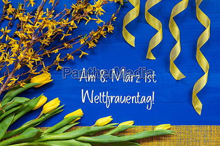 spring flowers branch ribbon weltfrauentag mean
