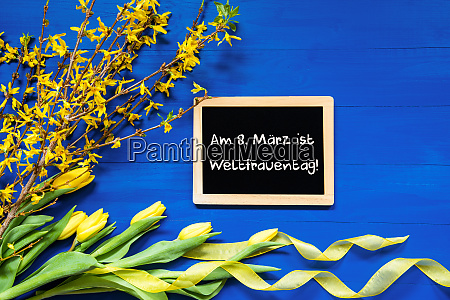 spring flowers branch blackboard weltfrauentag mean