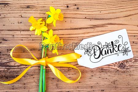 yellow narcissus flower label calligraphy danke