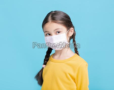 sick girl child in medical mask