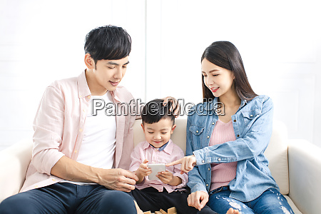 happy family watching the smart phone