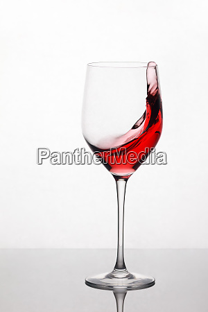 splashing and moving red wine in