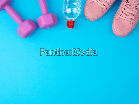 purple dumbbells and a clear plastic