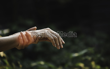 female holding wrist pain in a