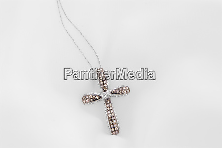white gold cross pendant with chocolate