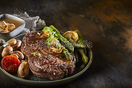 seasoned thick grilled beef steak with