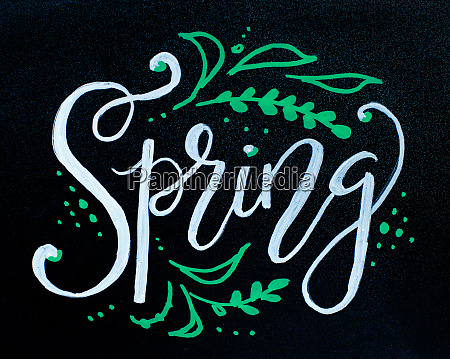 chalkboard with spring lettering