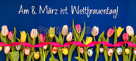 banner with colorful tulip weltfrauentag means