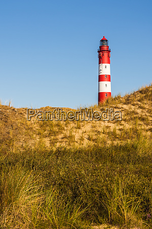 lighthouse in the dune landscape of