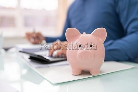 businessman calculating finances