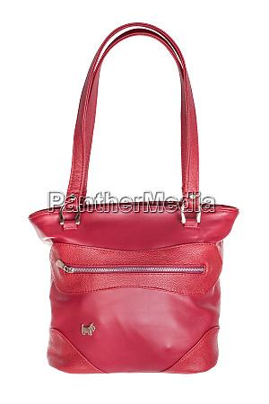 closed handmade red leather handbag isolated