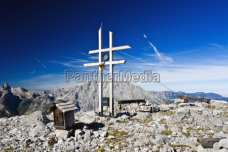 a sunny summit cross in the