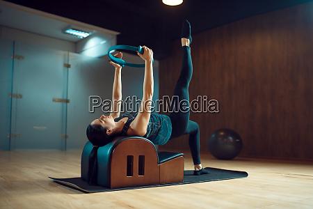 slim girl on pilates training in