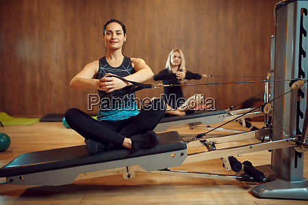 two women on pilates training in