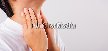 asian beautiful woman sore throat or