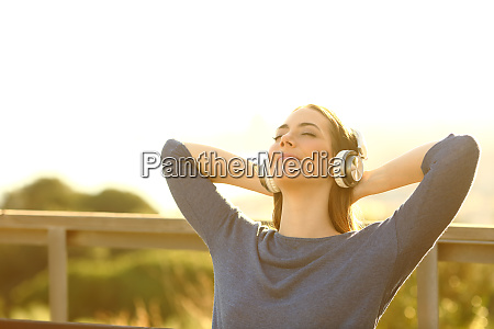 relaxed woman listening to music in
