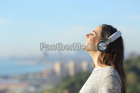 happy girl breathing with headphones enjoying