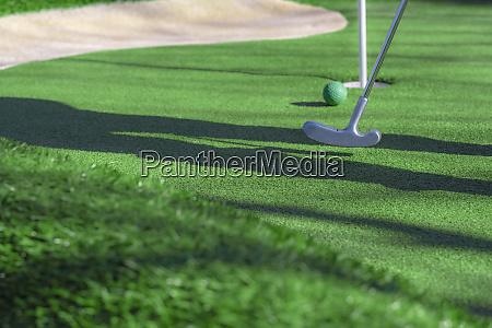 mini golf club ball and hole