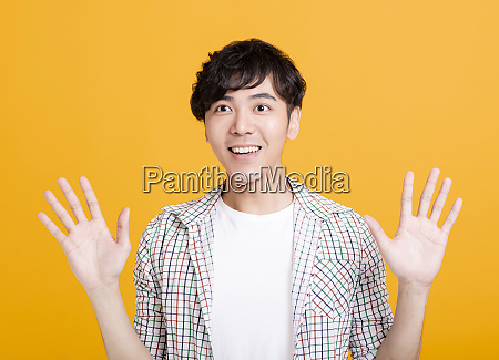 happy surprised asian young man