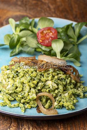 bavarian spinach spaetzle on a blue