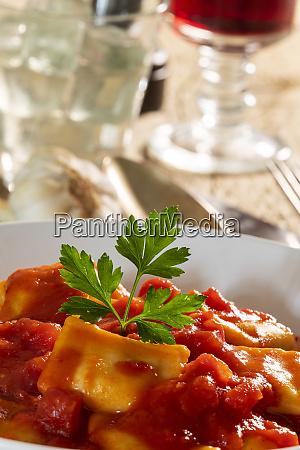 ravioli with tomato sauce on a