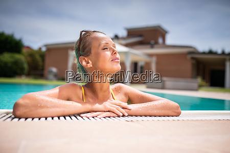 young beautiful suntanned woman relaxing next