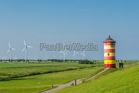 pilsum lighthouse with wind turbines north