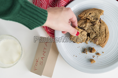 woman picking up cookie by card