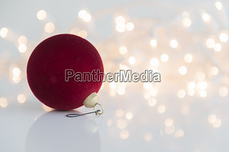 red bauble against lights