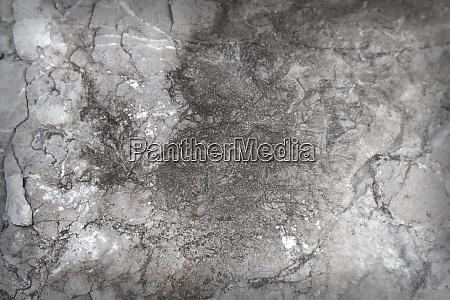 dark textured stone surface