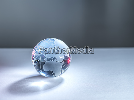 a glass globe of planet earth