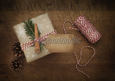 carrot and pine frond tied to