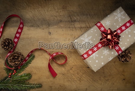 christmas present pine fronds pinecones and