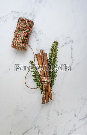 cinnamon and pine fronds tied with