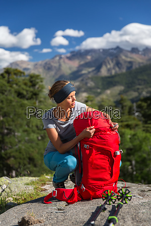 pretty female hiker in high mountains