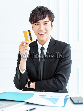 smiling young businessman showing the