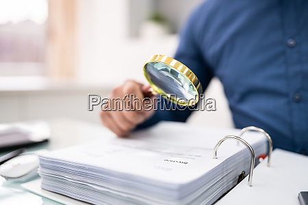 businessperson checking bills