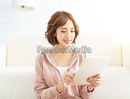 happy casual beautiful woman working on