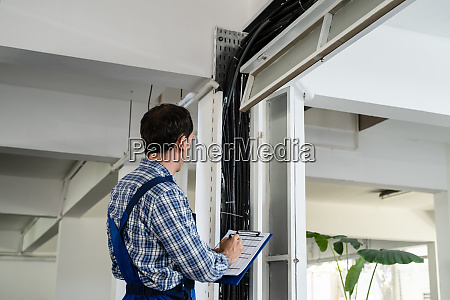 male electrician installing cables