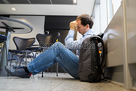 upset man in airport flight delay