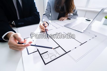 two architects discussing blueprint