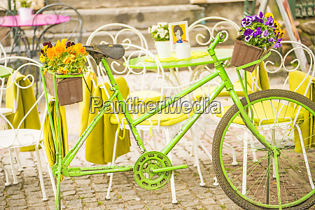 bicycle with flowers at a street