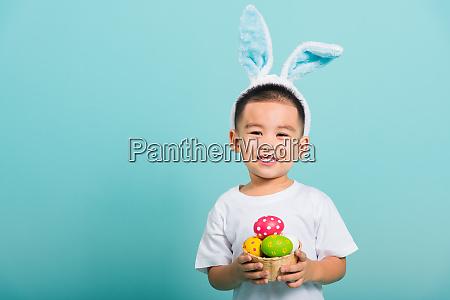 little child boy smile wearing bunny