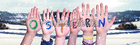 children hands building word ostern means