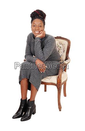 lovely black female sitting in an