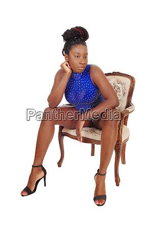 tall african american woman sitting sin