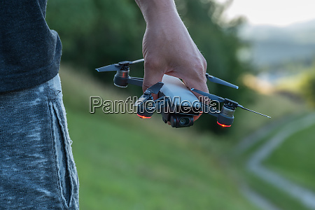 hand holds flight drone