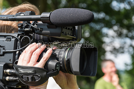 man works with film camera